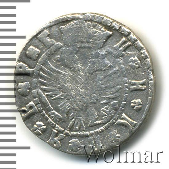 Гривна 1709 г. БК. Петр I Розетки разделяют круговую надпись. Тиражаня монета