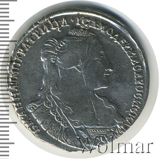 Полтина 1734 г. Анна Иоанновна Тип года. С кулоном на груди. Крест державы простой
