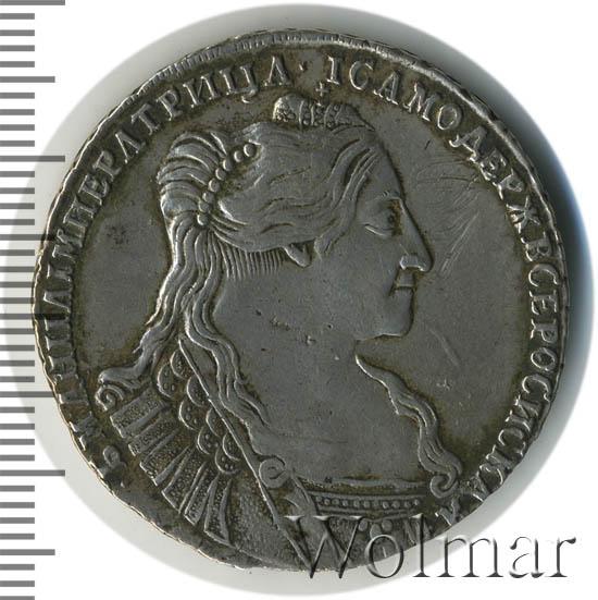 Полтина 1734 г. Анна Иоанновна Тип года. С кулоном на груди. Крест державы узорчатый