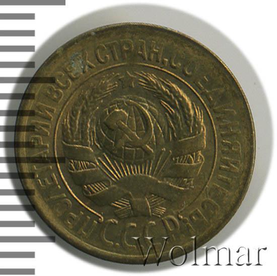 1 копейка 1928 г. Между рукоятью молота и рукоятью серпа проходит одна параллель