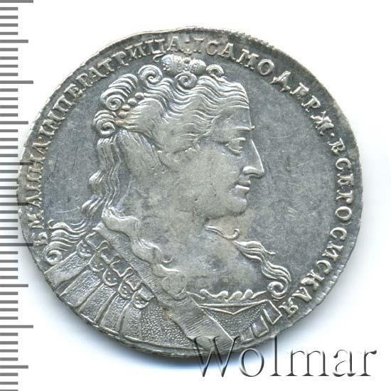 1 рубль 1734 г. Анна Иоанновна. Лирический портрет. Большая голова. Крест короны разделяет надпись. Дата слева от короны