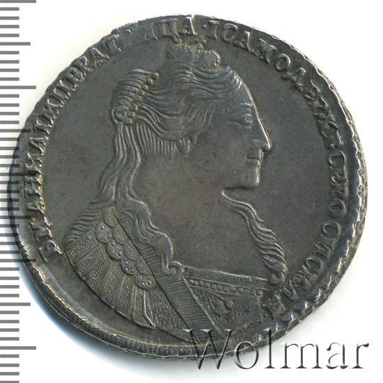 1 рубль 1734 г. Анна Иоанновна Тип года. С кулоном на груди. Три ленты наплечника на левом плече. 8 жемчужин в волосах